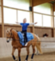 young girl with blue dress is vaulting.j