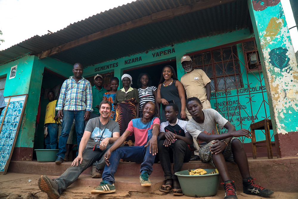 Our video crew and local villagers on location in Tanzania