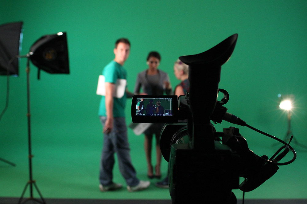 Our video crew setting up a green screen shoot
