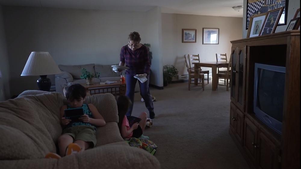 Grandmother brings food to children.