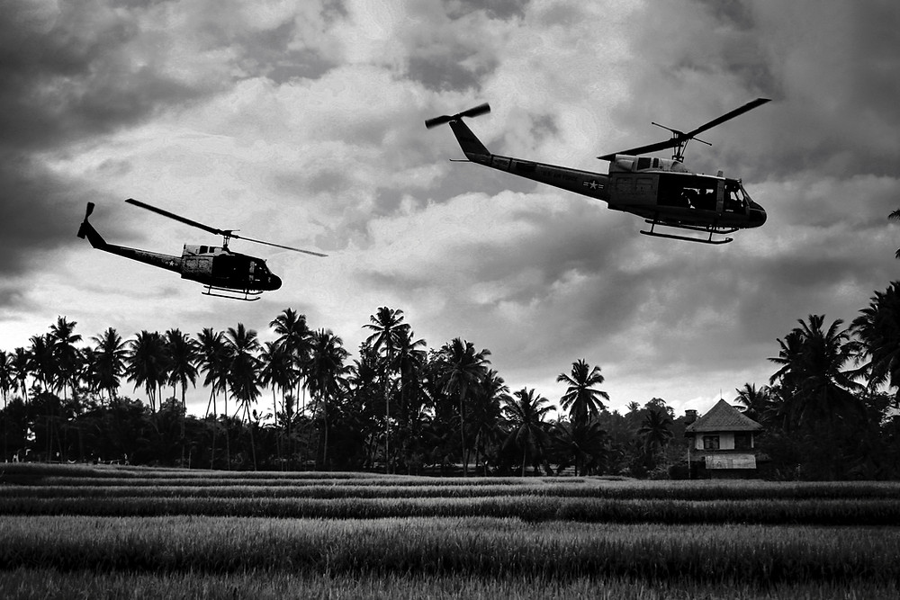 2 helicopters fly low in Viet Nam