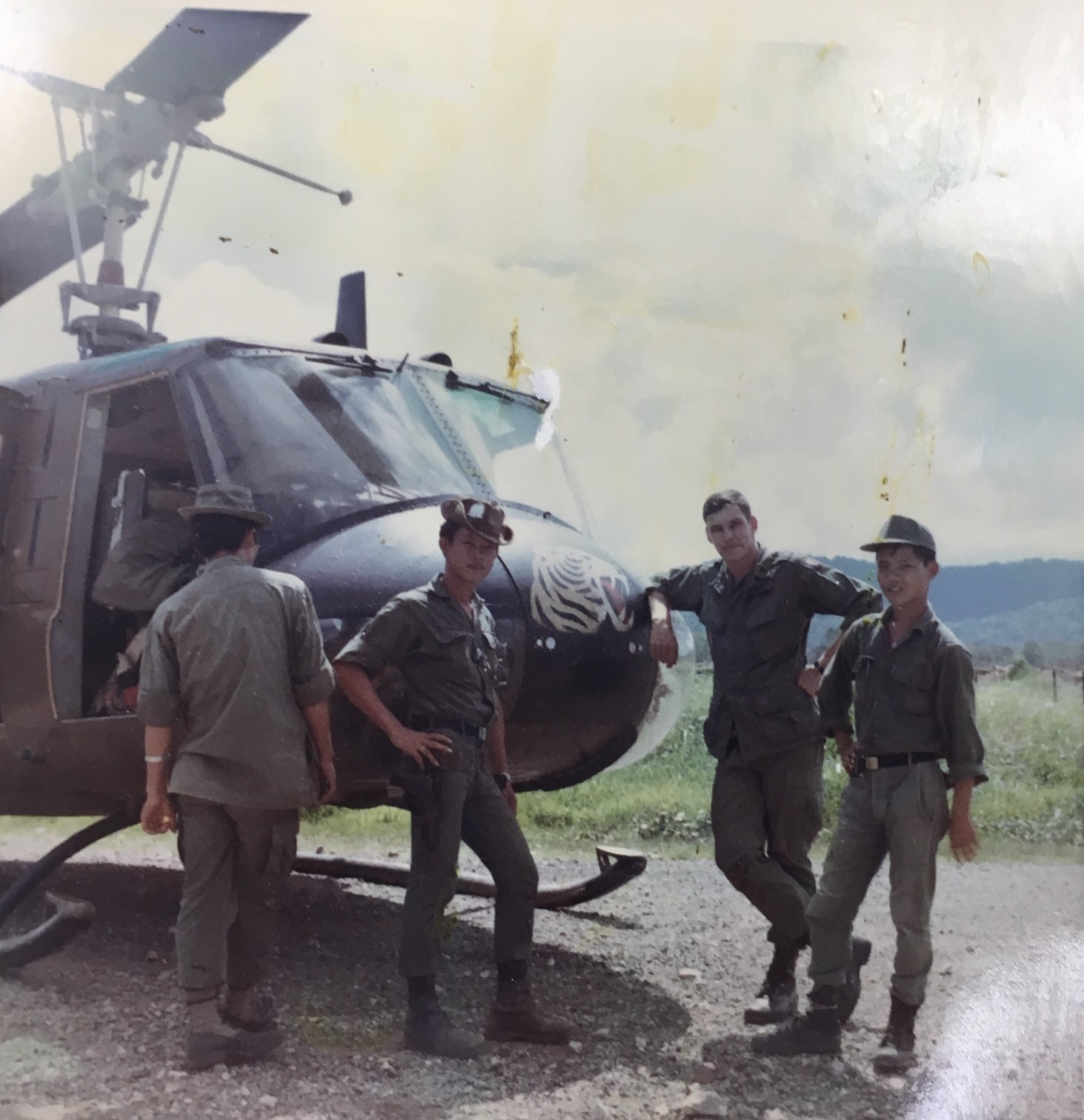 Scott Alwin with helicopter and young Vi