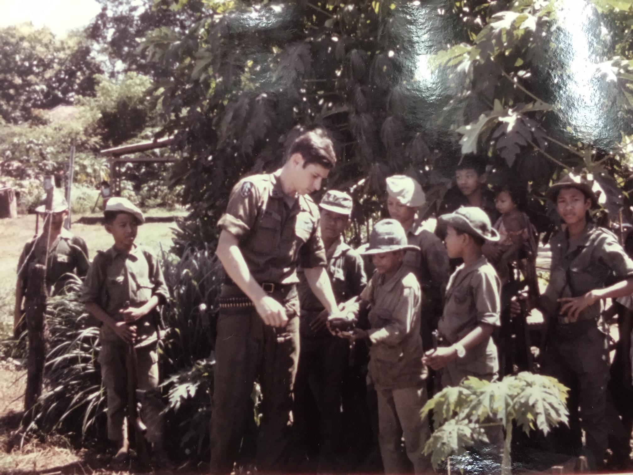 Scott Alwin with young Vietnamese soldie