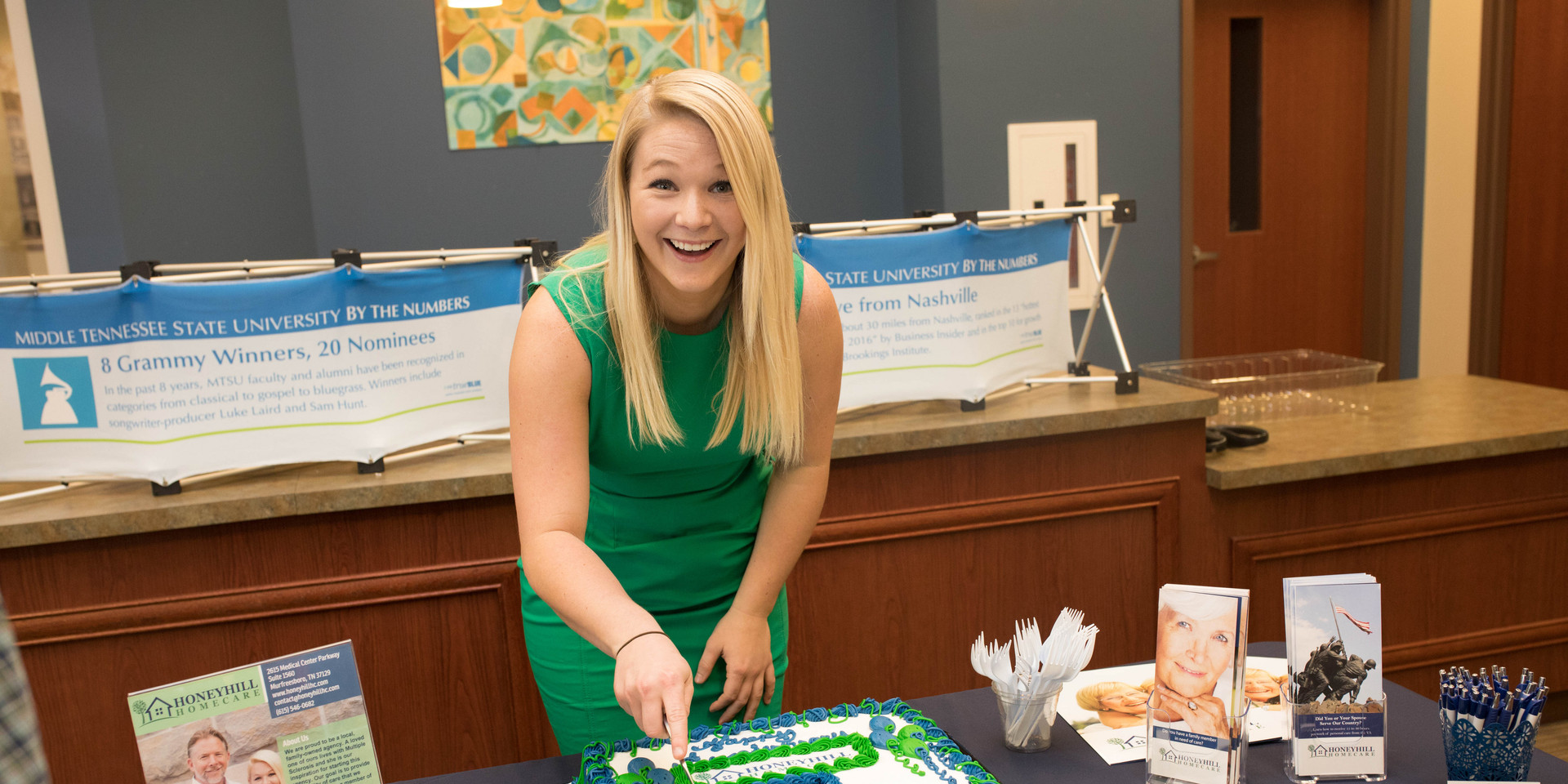 Happy to be cutting the cake!