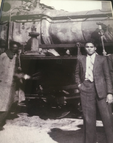 This is my saba, Salach (Tzvi) Dagmi. This picture is important to me, as it's a reminder of the vibrant Jewish Baghdadi community that lived in, and were an integral part of, the city and country. My saba worked at the train station selling train tickets and package postage slips.  Baghdad, 1947-49