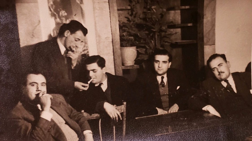 It's my grandfather and his friends.  Baghdad, 1950