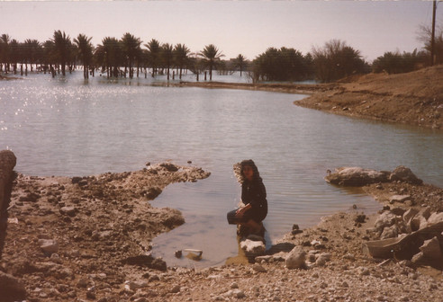 My parents went to Anah and Rawa during their honey moon; he wanted to introduce her to where he grew up. Rawa when this picture was taken was half drowned and the other half was fine as it was on a hill. After the Haditha Damm was filled, they relocated the people of Rawa to the upper area. Anah behind the person being photographed spans a length of 13kms.  My father grew up in Anah & finished high-school there, then moved to Baghdad in 1979 with his siblings and my grandparents, where he finished his bachelors. Schools in Rawa were up to Grade 9 - where students had to go to Anah to finish High-School.  Rawa, 1989
