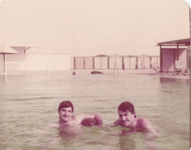 Basra International Airport housing compound - my father with a friend having a swim in the recreation area.  Basra, 1983