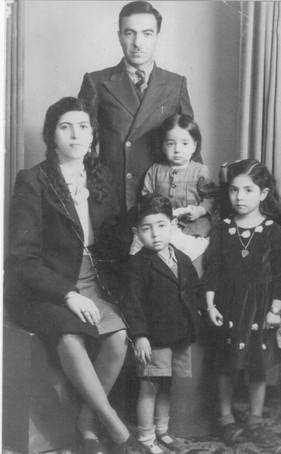 This photo is of Fatima Hashim, Kamal Kanber Wafi and my dada Muafaq Wafi few months old with his sister Nawal and brother Aqeel.  Amara, 1945
