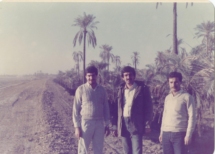 My father with two of his friends standing by a Farm in Al Faw City. Iraq has a lot of resources, agriculture, great soil, water sources, natural water flows. It is important that we highlight that there is more to Iraq than war and catastrophe.  Al Faw, 1986