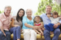 Multi Generation Family Sitting On Garde