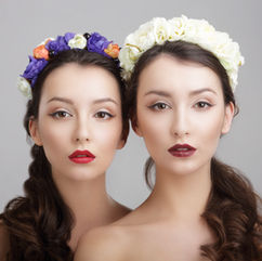 Beautiful fashion portrait of two models with makeup and flowers. Image captured by our professional fashion photographers at our studio in Dubai.