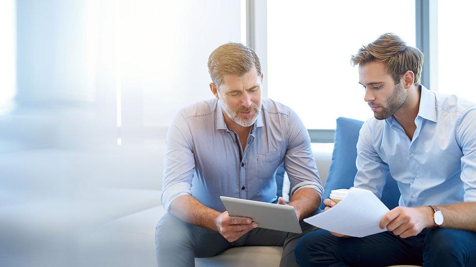 Mature businessman using a digital table