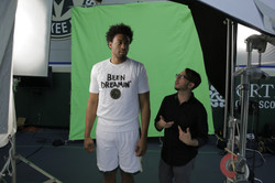Filling Jabari in on the shoot.