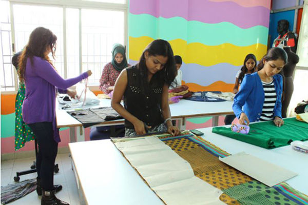 Students During One Of Thier Fashion Designing Course Classes | Cutting Clothes in Lab