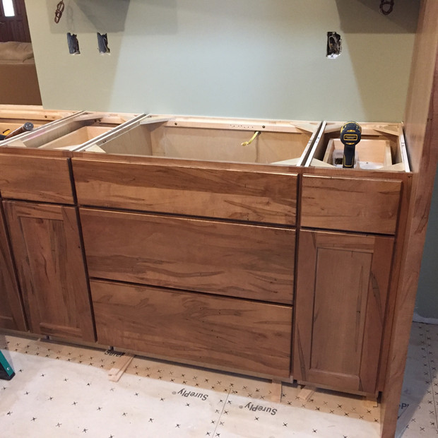 wormy-cypress-base-cabinet-going-in