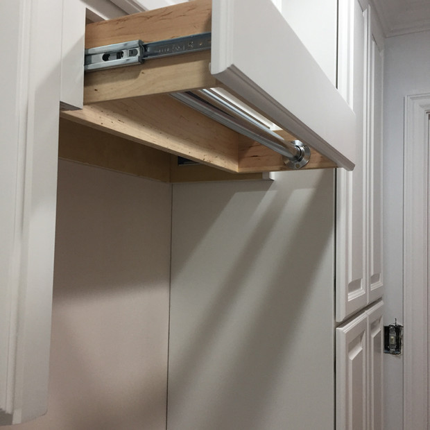 white-laundry-room-cabinets-hidden-rod-2