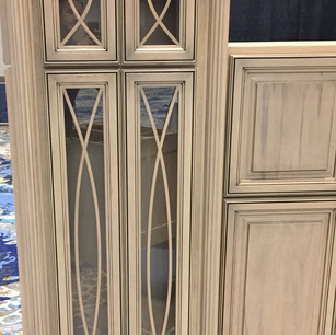 Ornate door design in custom stain and glaze for new construction