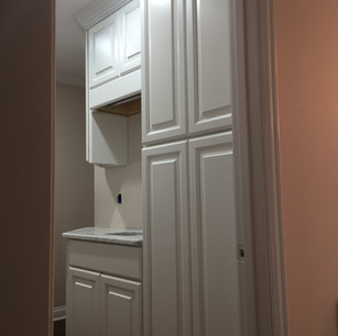white-laundry-room-pantry-cabinets-3