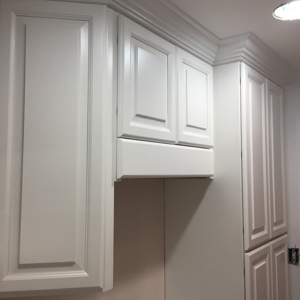 white-laundry-room-cabinets-hidden-rod-1