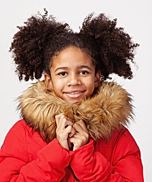 Cute teenage girl in red winter parka ag