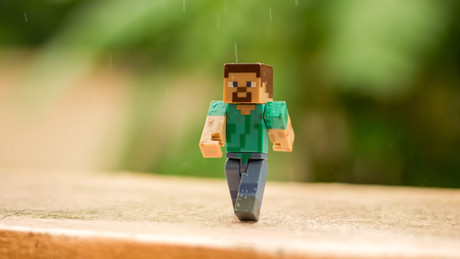 Why do kids love Minecraft, and how does it benefit them?