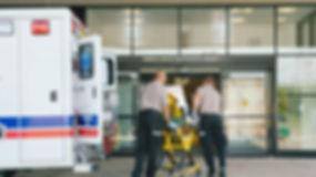 paramedics-taking-patient-on-stretcher-f