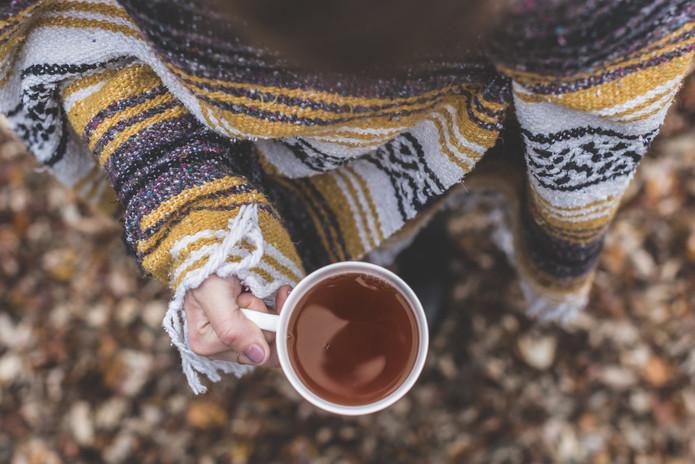 Canva - Holding a Herbal Tea Outdoors.jp