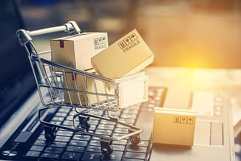 paper-boxes-in-a-shopping-cart-on-a-lapt