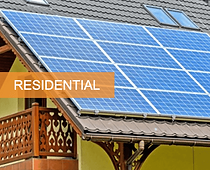 solar panels mounted on a slanting roof of a house