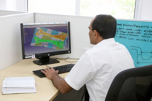 Reliable Autotech employee working on the cad files to design a die at the research and development centre