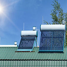 Solar water heating panels mounted in the sunlight, on a rooftop | Solar Water Heating System