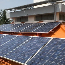 Solar panels carefully mounted on the rooftop of a building | Rooftop Mounted PV Power Plant