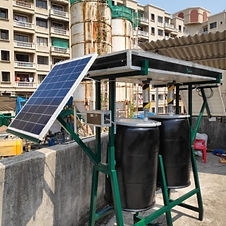 Solar compost machine carefully mounted on the terrace with buildings around | Solar Compost Machine