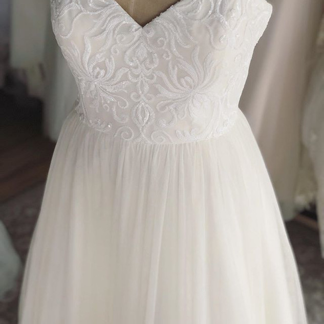 "Our beautiful, ""Chloe"" gown has been mar"