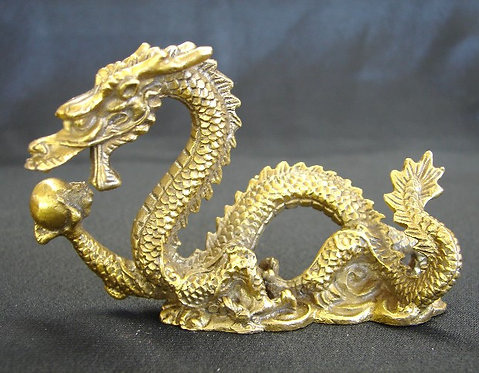 Brass Dragon Swimming After The Wisdom Pearl