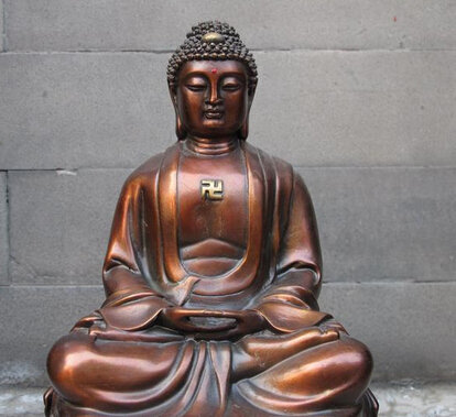 The Red Bronze Buddha In Meditation