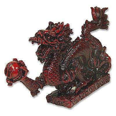 Red Dragon Perches Upon Pillar