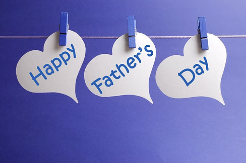 Happy Fathers Day message written on whi