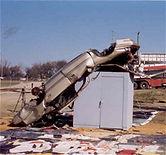 Car dropped on tornado shelter / storm shelter
