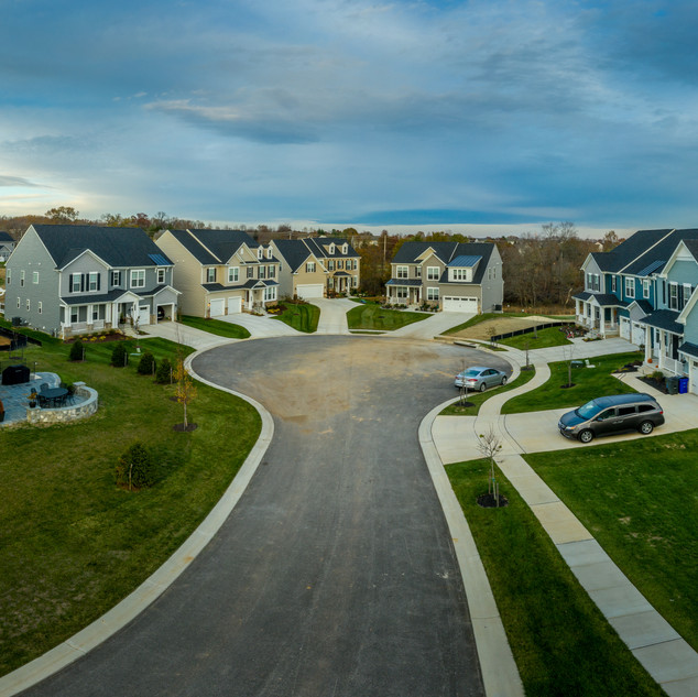 Aerial view of new construction street w