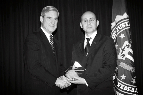 Bilal Eksili with FBI Director Robert Mueller