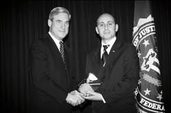 Bilal Eksili with FBI Director Robert Mueller