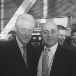 Bilal Eksili with President Bill Clinton