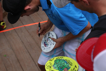 Ricky signing discs for the volunteers