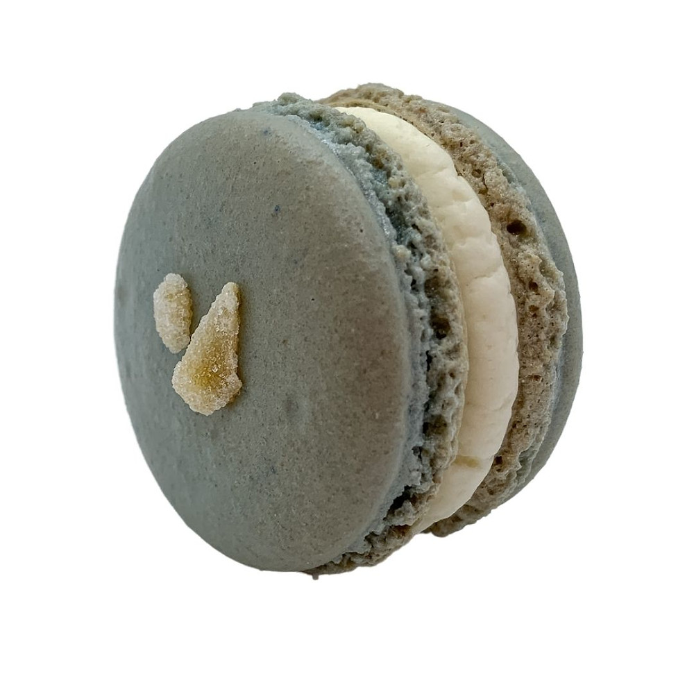 Light blue almond macaron shell with ginger buttercream & ginger preserves; topped with crystallized ginger.
