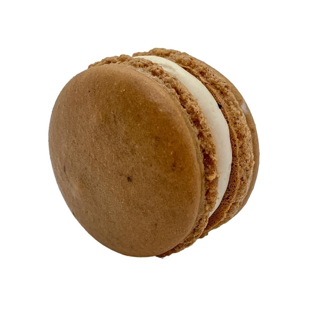 Light brown coffee almond macaron shell with cardamom vanilla buttercream.