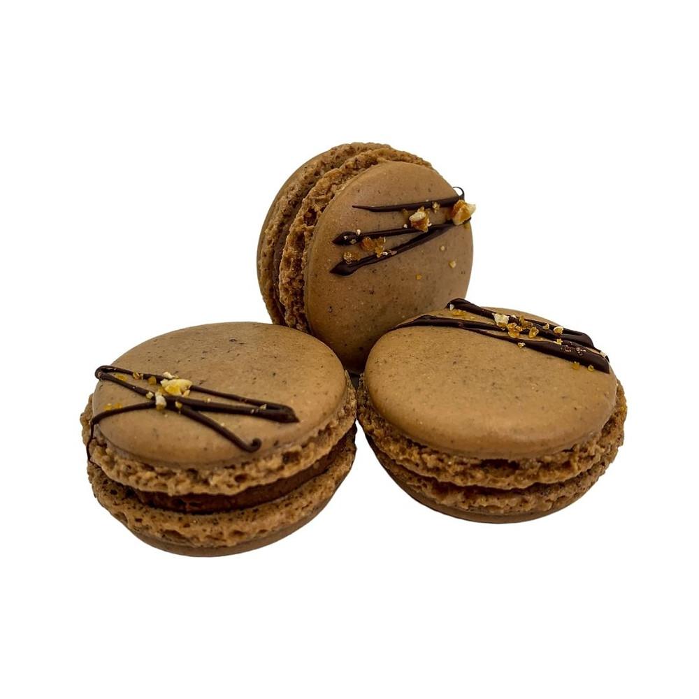Warm brown hazelnut almond macaron shell with hazelnut praline (gianduja) dark chocolate ganache.