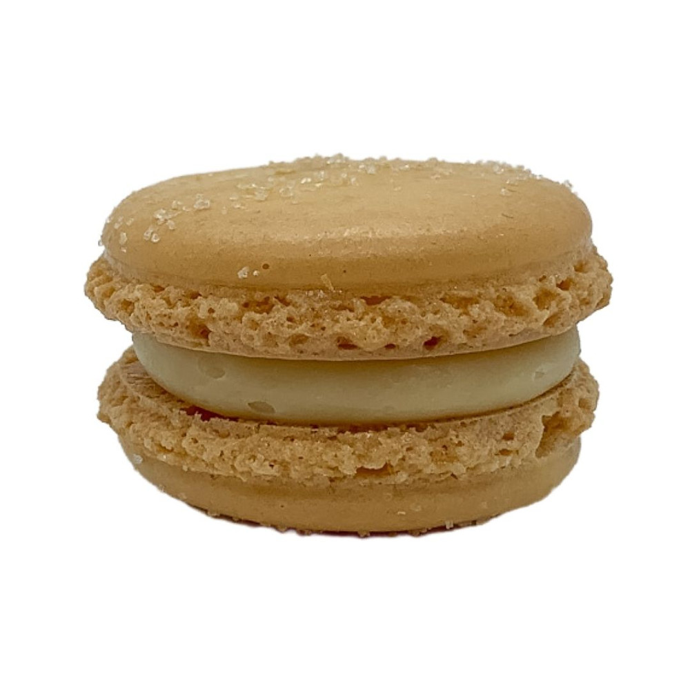 Yellow almond macaron shell with lapsang souchong white chocolate ganache; dusted with lemon sugar.