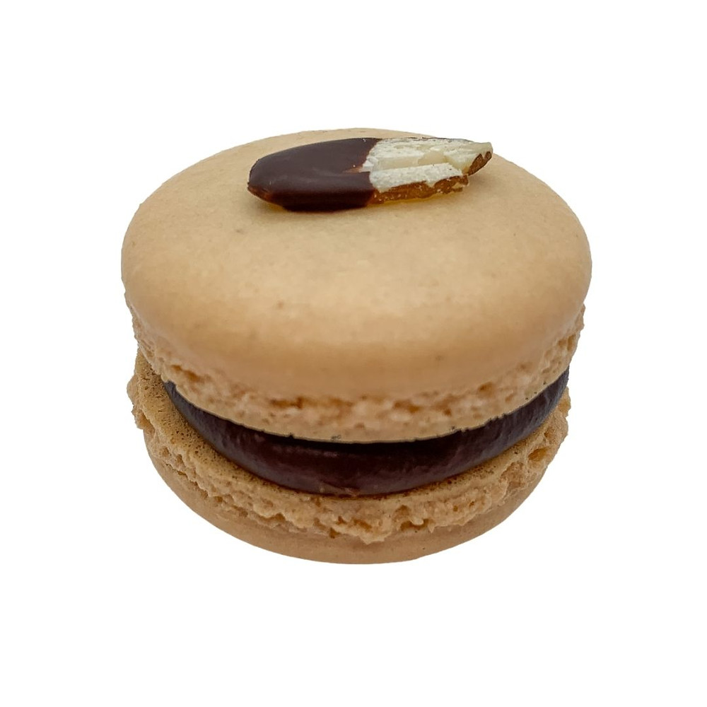 Off-white almond macaron shell with hazelnut praline dark chocolate ganache and almond marzipan; topped with a dark chocolate dipped almond sliver.